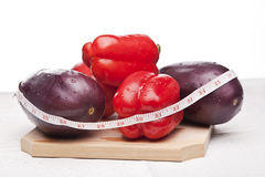 Delicious red peppers and eggplants Stock Photography