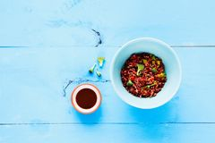 Rice and broccoli bowl. Delicious red rice and broccoli bowl. Vegetarian, healthy, diet food concept. On light blue wooden table, top view. Flat lay Royalty Free Stock Photo