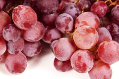 Delicious red seedless grapes on white background Stock Photos