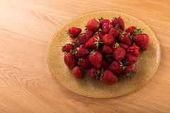 Delicious red strawberries on the plate. Beautiful supply of fruit. Photo for culinary magazines, posters, backdrops and websites Royalty Free Stock Photography