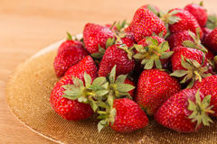 Delicious red strawberries on the plate. Beautiful supply of fruit. Photo for culinary magazines, posters, backdrops and websites Stock Photo