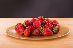 Delicious red strawberries on the plate. Beautiful supply of fruit. Photo for culinary magazines, posters, backdrops and websites Royalty Free Stock Images