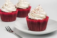 Delicious red velvets cupcake on white background. suitable for the party and gift. Delicious red velvet cupcakes on white background. suitable for the party Stock Image
