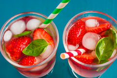 Delicious refreshing drink with fresh strawberry and basil Stock Photo