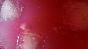 Delicious and refreshing strawberry cocktail with ice. 4K UHD. Native video stock footage
