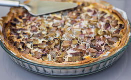 Delicious rhubarb tart with sugar. In a glass bowl on a table Stock Image