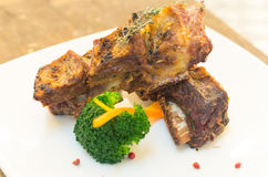 Delicious rib steak and vegetables placed on white Stock Photo