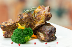 Delicious rib steak and vegetables placed on white Stock Image