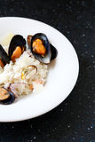 Delicious rice with cheese risotto and mussels Stock Photography