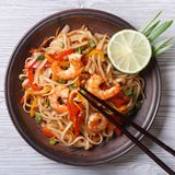 Delicious rice noodles with shrimp and vegetables top view stock images