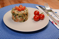 Tasy rice pilaf. Delicious rice pilaf with vegetables on a blue background Stock Image