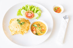 Delicious rice and red curry with pork and omelet (Thai panang c Stock Photos
