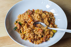 Delicious rice with stewed vegetables and sausages Stock Images
