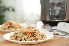 Delicious rice with vegetables on wooden table, closeup. Multi cooker recipes stock images