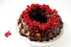 Delicious ring cake with chocolate and red currants Royalty Free Stock Images