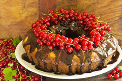 Delicious ring cake with chocolate and red currants Royalty Free Stock Photography