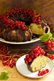 Delicious ring cake with chocolate and red currants Royalty Free Stock Photos