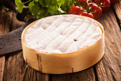 Delicious ripe French camembert cheese in a box Royalty Free Stock Photography
