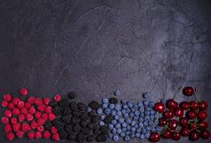 Delicious ripe fruits and berries, close-up. Fruit banner. Selection of healthy vegetarian food, detox or diet. Delicious ripe fruits and berries on black stock image