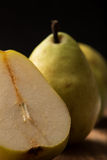Delicious, ripe pears on a wooden kitchen table, closeup, vertic Stock Photography
