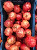 Delicious ripe pomegranates on the market in the box royalty free stock photography