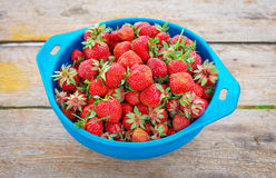 Delicious ripe strawberries on the bow Stock Photos