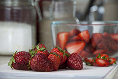 Delicious, ripe strawberries on cutting board Stock Photography