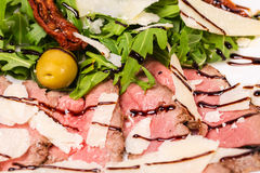 Delicious roast beef with arugula and parmesan. Royalty Free Stock Images