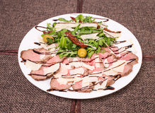 Delicious roast beef with arugula and parmesan. Royalty Free Stock Photo