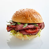 Delicious roast beef burger with salad trimmings Royalty Free Stock Photography