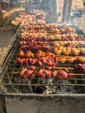 Delicious roast chicken, thai street food, on the grill with smoke stock photo