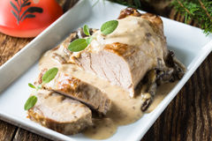 Delicious roast pork fillet with mushroom sauce Stock Image