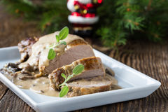 Delicious roast pork fillet with mushroom sauce Royalty Free Stock Photos