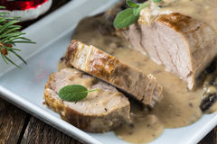 Delicious roast pork fillet with mushroom sauce Stock Photography