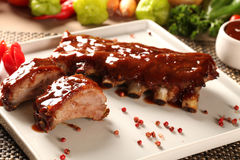 Delicious roast pork rib won white dish. Stock Photo