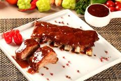Delicious roast pork rib won white dish. Royalty Free Stock Photography