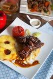 Delicious roast pork rib won white dish. Barbecue cream. Stock Photos