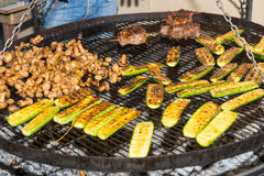 Delicious roasted or barbecued fresh vegetables and meat on hot Stock Photography