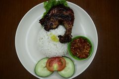 Delicious roasted chicken on a plate with chili sauce stock images