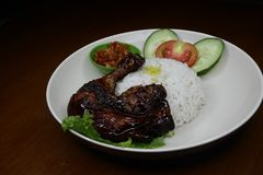 Delicious roasted chicken on a plate with chili sauce royalty free stock photos