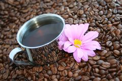 Delicious roasted Coffee. In silver cup Stock Photography
