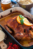 Delicious roasted duck with oranges in a pan, rustic style Stock Photos