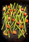 Delicious roasted green asparagus tips Stock Photography