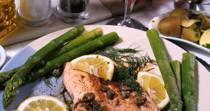 A delicious roasted organic salmon with capers and dill stock video footage