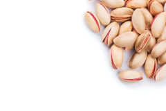 Delicious roasted pistachios on a white background Royalty Free Stock Photo