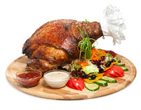 Delicious roasted pork leg with vegetables Royalty Free Stock Photo