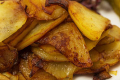 Delicious roasted potatoes. Stock Photos