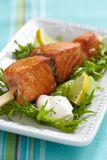 Delicious roasted salmon on skewers Stock Images