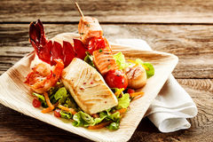 Delicious roasted seafood salad on plate Stock Images