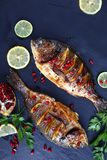 Delicious roasted spicy fish, top view stock images